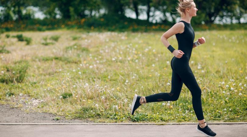 Female runner running outside