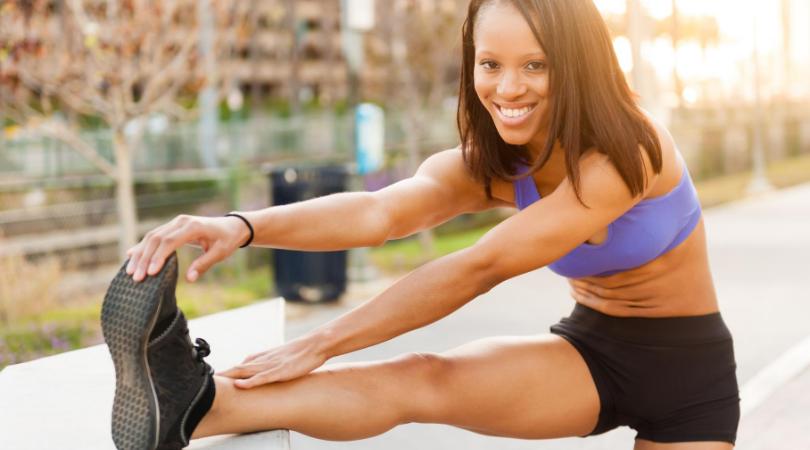 runner stretching after running