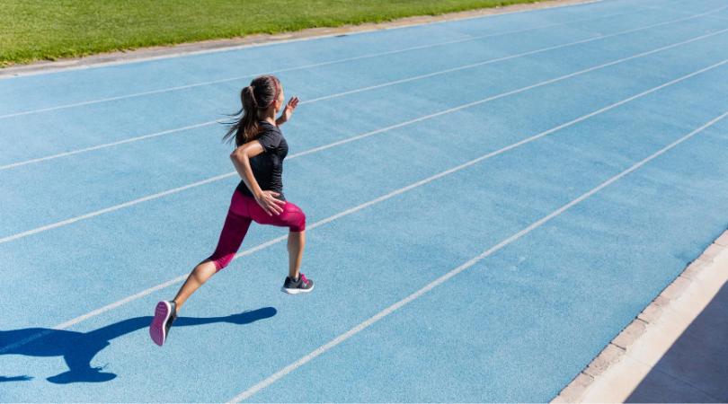 runner running on athletics track