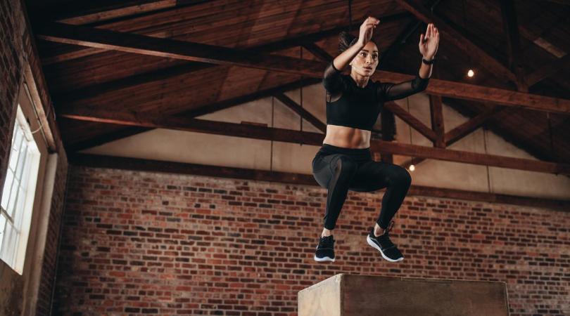 runner doing box jumps to help achilles pain