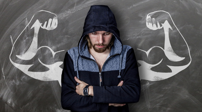runner looking depressed with powerful arms painting on the wall behind him