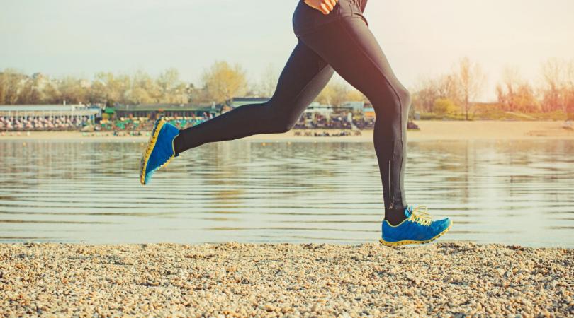 Runner running on sand surface