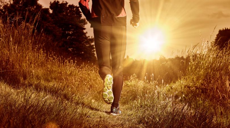 Runner running on grass surface
